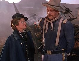 Joanne Dru en John Wayne in She Wore a Yellow Ribbon