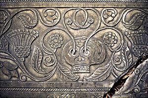Shebbear, Devon - Elaborately carved grave slab in Shebbear churchyard showing a skull sprouting flowering shoots as a symbol of resurrection