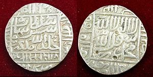 "One rupee (Indian coin) - Obverse: Trace of Kalima, name of four Khalifas, Sher Shah Suri's name and pious wish ""Khald Allah mulk""."