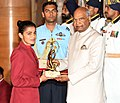 Shri Ram Nath Kovind presenting the Arjuna Award, 2018 to Savita Punia.jpg