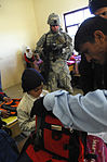 Soldiers deliver school supplies to children in Al Buaiibyes DVIDS139905.jpg