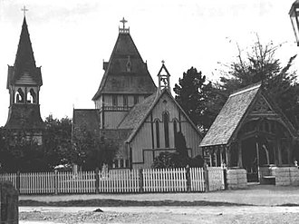 Benjamin Mountfort - St Augustine's Church in Waimate. Mountfort's Gothic in wood, designed in 1872, has the campanile of a medieval cathedral in miniature, neighboured by the roof of a chateau, entered by the lychgate of an English parish church, all successfully harmonised into a New Zealand landscape.