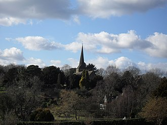 St Margaret's Church, West Hoathly - The tall broach spire, seen here from the fields southeast of the village, was added in the early 15th century.