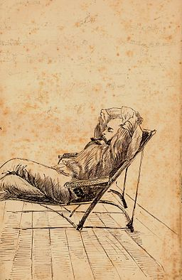 StateLibQld 2 224416 Charles Collinson Rawson relaxing on a deck chair on the verandah of The Hollow, Mackay, 1877