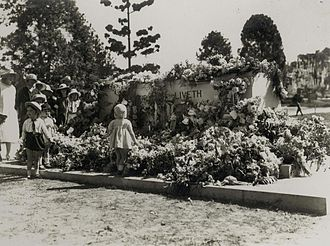 Children with a wreath-laden Stone of Remembrance on Anzac Day in 1924 StateLibQld 2 254828 Small children looking at wreaths laid at the memorial on Anzac Day, Toowong Cemetery, Brisbane, 1924.jpg