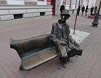 Statue of a sitting man (7993606288).jpg