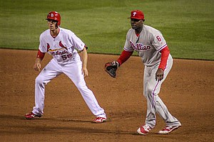 Stephen Piscotty - First baseman Ryan Howard (right) of the Philadelphia Phillies holding Piscotty on the base path in a game in 2016