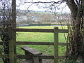 Stile and meadow running down to the Grand Union Canal - geograph.org.uk - 62049.jpg