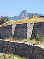 Stone Wall with Mountain Backdroop - Girne (Kyrenia) - Turkish Republic of Northern Cyprus (28566913675).jpg