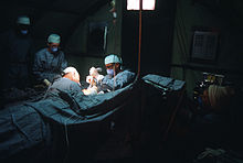 Surgeons operate on a patient at the 363rd Tactical Hospital during the multinational joint service Exercise Bright Star '85 DF-ST-86-07989.jpg