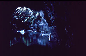Surtshellir - Entrance, seen from within. The white slab is ice, which was preserved into summertime.