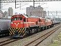 TRA R181 and grain hopper cars at North Hsinchu Station 20150810.jpg