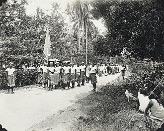 Mata'afa Faumuina Fiame Mulinu'u I - Mau carrying the coffin of Tupua Tamasese Lealofi III. Standing to the right wearing a single white stripe on his lava-lava, the Mau uniform, is Mata'afa Faumuina Fiame Mulinu'u I.