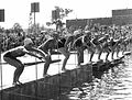 Ten swimmers lining up to start a race at Green Lake while a crowd watches, Seattle, Washington, ca. 1929-1932.jpg