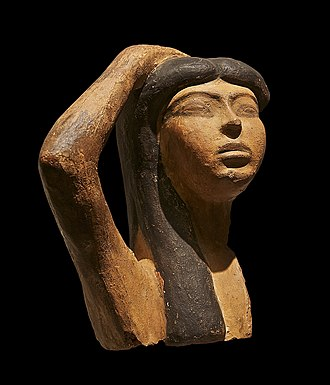 Isis - Sculpture of a woman, possibly Isis, in a pose of mourning; 15th or 14th century BCE