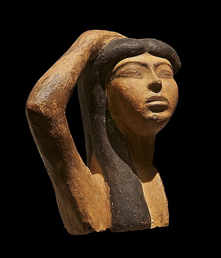 Terracotta sculpture of a woman with her arm flung across her forehead
