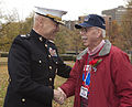 The Assistant Commandant of the Marine Corps, Gen. John M. Paxton, Jr., left, greets a veteran during an Honor Flight event at the Marine Corps War Memorial in Arlington, Va., Sept 131112-M-KS211-008.jpg
