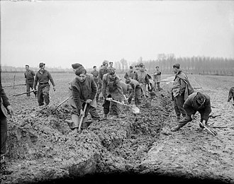 British Expeditionary Force (World War II) - 1st Royal Irish Fusiliers digging a trench near Nomain on the Franco-Belgian border, February 1940.