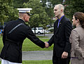 The Commanding Officer of Marine Barracks Washington, Col. Christian G. Cabaniss, left, greets honorary Marine Daran Wankum during a wreath laying ceremony at the Marine Corps War Memorial in Arlington, Va 130613-M-KS211-001.jpg