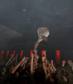 Greg Puciato singing while hanging head down from the ceiling in 2008 The Dillinger Escape Plan-1.jpg