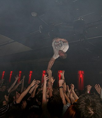 The Dillinger Escape Plan - Greg Puciato hanging upside down during a Dillinger show in 2008.