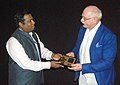 The Director, DFF, Shri C. Senthil Rajan felicitating the Life Time Achievement Awardee and the Director of 'BURNT BY THE SUN', Nikita Mikhalkov, at the 46th International Film Festival of India (IFFI-2015), in Panaji, Goa.jpg