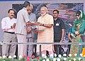 The Prime Minister, Shri Narendra Modi distributing the Cards for free medical treatment at Shri Mata Vaishno Devi Narayana Hospital, at Katra, in Jammu and Kashmir (1).jpg