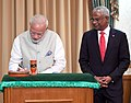 The Prime Minister, Shri Narendra Modi signing the visitors' book, in Male, Maldives on November 17, 2018. The President of Maldives, Mr. Ibrahim Mohamed Solih is also seen.JPG