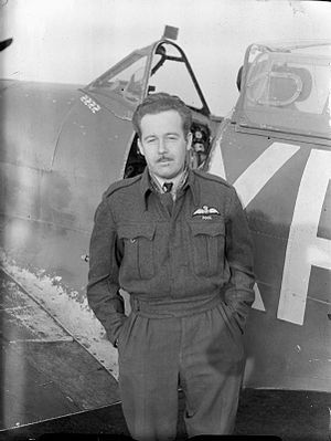 "No. 71 Squadron RAF - Pilot Officer C W ""Red"" McColpin of No 71 (Eagle) Squadron RAF, standing by his Supermarine Spitfire Mark VB at North Weald, Essex."