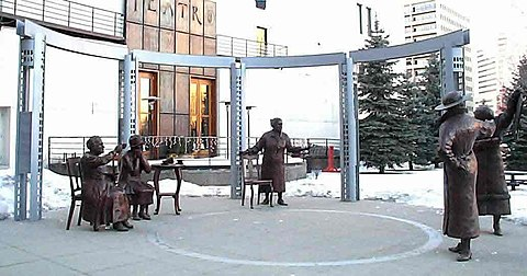 Statue in downtown Calgary of the Famous Five. An identical statue exists on Parliament Hill, Ottawa The Valiant Five Statue.jpg