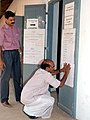 The polling officials pasting the candidate list who are contesting the General Election-2009 at one of the polling station at Manacaud, Trivandrum, in Kerala on April 16, 2009. cnr-25733.jpg