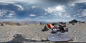 Tochal - A 360° View from Tochal peak. Visible are the two shelters on the peak, as well as Mount Damavand on the horizon, as well as Tehran.