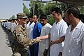 U.S. Air Force Col. Mark Holland, the command surgeon with National Training Mission-Afghanistan, greets staff members at the Kandahar Regional Medical Hospital Aug. 19, 2013, at Kandahar Airfield, Afghanistan 130819-A-VM825-054.jpg