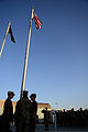U.S. Air Force honor guard members assigned to the 455th Air Expeditionary Wing raise a U.S. flag during a retreat ceremony at Bagram Airfield, Afghanistan, Sept 140911-F-PB969-025.jpg
