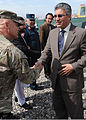 U.S. Army Lt. Col. Gordon Bartley, left, the officer in charge of the Herat area office of the U.S. Army Corps of Engineers Afghanistan Engineer District-South, greets Herat provincial Gov 120401-A-UU828-054.jpg