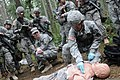 U.S. Army Sgt. Guang Quan, right, uses a medical mannequin to demonstrate the proper way to examine a casualty while training Soldiers attempting to earn the Expert Field Medical Badge at Joint Base 130401-A-ER359-944.jpg