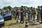 U.S. Army paratroopers with the 1st Battalion, 503rd Infantry Regiment, 173rd Airborne Brigade Combat Team attend a class on traffic control checkpoints led by Ukrainian soldiers in Yavoriv, Ukraine, July 10 130710-O-ZZ999-001-UA.jpg