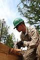 U.S. Marine Corps Lance Cpl. Bennett Russ, with the 9th Engineer Support Battalion, 3rd Marine Logistics Group, III Marine Expeditionary Force, removes frames from new concrete during renovation work on 130725-M-DR618-029.jpg