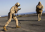 U.S. Marines assigned to Battalion Landing Team 3-2, 26th Marine Expeditionary Unit (MEU), carry gear after fast roping from a CH-53E Super Stallion assigned to Marine Medium Tiltrotor Squadron (VMM) 266 130630-M-SO289-020.jpg