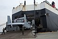 U.S. Marines with Marine Medium Helicopter Squadron (HMM) 262 unload 12 MV-22 Osprey tiltrotor aircraft July 30, 2013, at the port facility at Marine Corps Air Station Iwakuni, Japan 130730-M-YH418-012.jpg