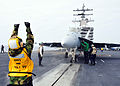 U.S. Navy Aviation Boatswain's Mate (Handling) 2nd Class Cynthia Jimenez directs an F-A-18F Super Hornet aircraft assigned to Strike Fighter Squadron (VFA) 2 on the flight deck of the aircraft carrier USS Ronald 130506-N-EC099-186.jpg