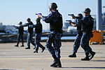 U.S. Sailors assigned to the aircraft carrier USS George H.W. Bush (CVN 77) conduct security drills during a force protection exercise Oct. 2, 2013, at Naval Station Norfolk, Va 131002-N-MW819-092.jpg