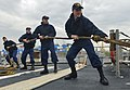 U.S. Sailors perform line handling duties as the guided missile cruiser USS Monterey (CG 61) departs Livorno, Italy, April 26, 2013, after a port visit 130426-N-QL471-079.jpg