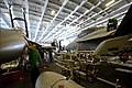 U.S. Sailors perform maintenance two F-A-18F Super Hornet aircraft in the hangar bay of the aircraft carrier USS John C. Stennis (CVN 74) in the Indian Ocean March 28, 2013 130328-N-TC437-069.jpg