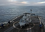 U.S. Sailors secure an SH-60 Sea Hawk helicopter assigned to Helicopter Sea Combat Squadron (HSC) 21 aboard the guided missile frigate USS Thach (FFG 43) June 25, 2013, while underway in the Pacific Ocean 130625-N-UL721-153.jpg