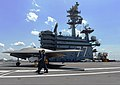 U.S. Sailors tow a Navy X-47B unmanned combat air system demonstrator aircraft on the flight deck of the aircraft carrier USS George H.W. Bush (CVN 77) off the coast of Norfolk, Va., May 10, 2013 130510-N-FU443-068.jpg