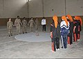 U.S. Soldiers assigned to the female engagement team with the 1st Brigade Combat Team, 1st Armored Division line up across from the Kandahar women's basketball team prior to a game in Kandahar City, Kandahar 130322-A-IX573-009.jpg