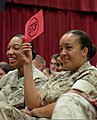 "U. S. Marine Lance Cpl. Jessie Lesuer, administration specialist, Installation Personnel Administration Center, holds up a stop sign during a performance of ""Sex Signals"" at the Marine Corps Base theater 110920-M-TH981-002.jpg"