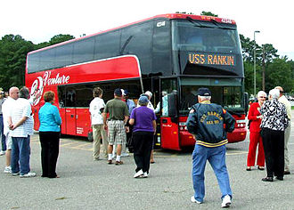 American Bus Association - A tour group boarding their bus. Technically speaking, it is a motorcoach.