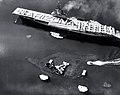 USS Bennington (CVA-20) passes the wreck of USS Arizona (BB-39) in Pearl Harbor, Hawaii (USA), on 31 May 1958 (USN 1036055).jpg